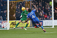 AFC Wimbledon defender Deji Oshilaja (4) trying to connect with a through bal during the EFL Sky Bet League 1 match between AFC Wimbledon and Northampton Town at the Cherry Red Records Stadium, Kingston, England on 10 February 2018. Picture by Matthew Redman.