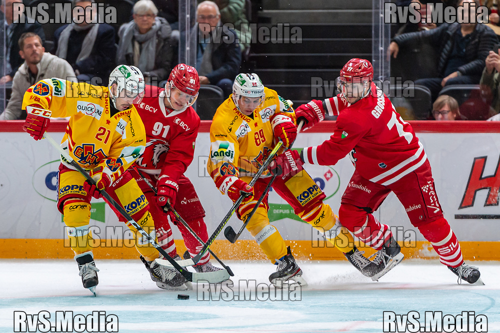 LAUSANNE, SWITZERLAND - NOVEMBER 15: #21 Jason Fuchs of EHC Biel and #89 Tino Kessler of EHC Biel battles for the puck with $#91 Joel Vermin of Lausanne HC and #77 Robin Grossmann of Lausanne HC during the Swiss National League game between Lausanne HC and EHC Biel-Bienne at Vaudoise Arena on November 15, 2019 in Lausanne, Switzerland. (Photo by Monika Majer/RvS.Media)
