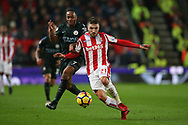 Kostas Stafylidis of Stoke City holds off Raheem Sterling of Manchester City. Premier league match, Stoke City v Manchester City at the Bet365 Stadium in Stoke on Trent, Staffs on Monday 12th March 2018.<br /> pic by Andrew Orchard, Andrew Orchard sports photography.