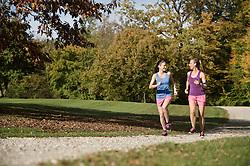 Women jogging in park, Woerthsee, Bavaria, Germany