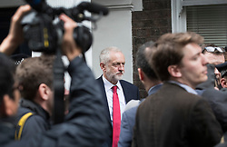 © Licensed to London News Pictures. 12/05/2017. London, UK. Labour party leader Jeremy Corbyn is surround by reporters as he leaves Chatham House after outlining his national security and foreign policy in a speech. The general election is on June 8, 2016. Photo credit: Peter Macdiarmid/LNP