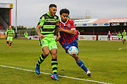 Forest Green Rovers Kaiyne Woolery(14) chases the ball under pressure from Dagenham'sJoe Widdowson(3) during the Vanarama National League first leg play off match between Dagenham and Redbridge and Forest Green Rovers at the London Borough of Barking and Dagenham Stadium, London, England on 4 May 2017. Photo by Shane Healey.