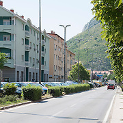 MOSTAR, BOSNIA AND HERZEGOVINA - JUNE 26:  A general view completeley renovated buildings on Bulevar which used to be front line in Muslim-Croatian war front on  June 26, 2013 in Mostar, Bosnia and Herzegovina.The Siege of Mostar reached its peak and more cruent time during 1993. Initially, it involved the Croatian Defence Council (HVO) and the 4th Corps of the ARBiH fighting against the Yugoslav People's Army (JNA) later Croats and Muslim Bosnian began to fight amongst each other, it ended with Bosnia and Herzegovina declaring independence from Yugoslavia.  (Photo by Marco Secchi/Getty Images)