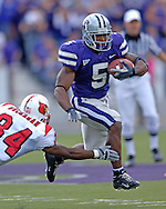 Kansas State running back Thomas Clayton (5) rushes past Louisville defensive back Bobby Buchanan (34) in the second half, at Bill Snyder Family Stadium in Manhattan, Kansas, September 23, 2006.  The 8th ranked Louisville Cardinals beat K-State 24-6.