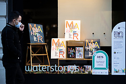 © Licensed to London News Pictures. 25/10/2020. Manchester, UK. Work by artists Tony Walsh and Trevor Johnson in the window of Waterstones ready for the 50 Windows of Creativity art trail which will run from October 26th to December 5th, turning the city in to a large scale art gallery. Photo credit: Kerry Elsworth/LNP
