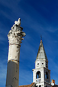 """""""Pillar of Shame"""", with Lion of St. Mark at top and belltower of Church of St. Zoilus in background. Roman Forum, Zadar, Croatia"""