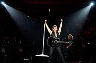 Jon Bon Jovi, center, performs during Bon Jovi's concert at the Amway Center in Orlando, Fla., Sunday, May 15, 2011.(AP Photo/Phelan M. Ebenhack)