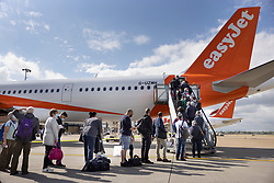 © Licensed to London News Pictures. 17/05/2021. Crawley, UK. Passengers board an EasyJet flight to Faro in Portugal from Gatwick Airport as step three on the roadmap out of lockdown begins. Travel to 12 countries on the green list is allowed from today. Holiday-makers returning home from green listed countries, including Portugal, Gibraltar and Iceland will not have to self-isolate on return. Various hospitality rules are also changing today - with pubs and restaurants allowed to serve seated customers indoors. Photo credit: Peter Macdiarmid/LNP