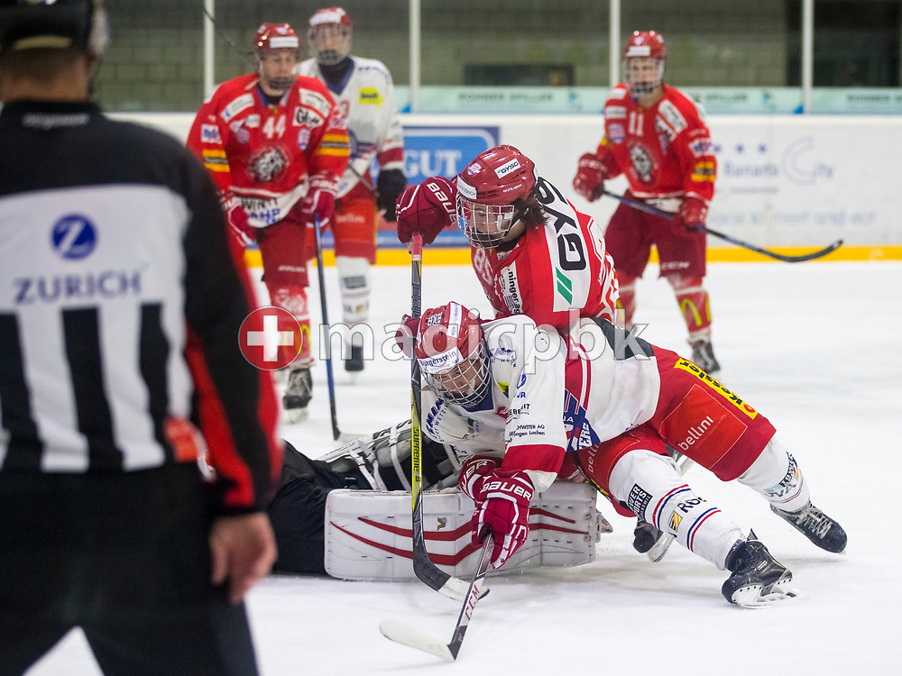 EHC Winterthur forward Levin Schneider (top) and Rapperswil-Jona Lakers forward Micha Jud are pictured during an Elite B Regular Season ice hockey game between EHC Winterthur and Rapperswil-Jona Lakers in Winterthur, Switzerland, Sunday, Oct. 15, 2017. (Photo by Patrick B. Kraemer / MAGICPBK)