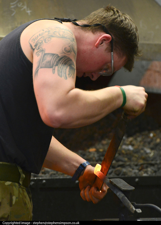 © Licensed to London News Pictures. 02/05/2013. London, UK. A farrier forges a piece of iron at The Household Cavalry Barracks at Hyde Park in central London today. The farriers in the regiment also serve as carers for the horses and can carry out minor Veterinary work.   Photo credit : Stephen Simpson/LNP