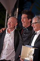 Screenwriter Paul Laverty, Irish cinematographer Robbie Ryan, Director Ken Loach, with the award Palme D'or  for Ken Loach's I, Daniel Blake<br /> at the Palm D'Or Winners photocall at the 69th Cannes Film Festival Sunday 22nd May 2016, Cannes, France. Photography: Doreen Kennedy