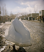 Woman with Burqa in Ishkashim, edge of the Wakhan Corridor. Burqas are non-existent in the Wakhan Corridor..Winter expedition through the Wakhan Corridor and into the Afghan Pamir mountains, to document the life of the Afghan Kyrgyz tribe. January/February 2008. Afghanistan