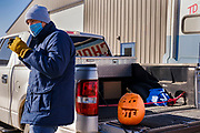 "01 NOVEMBER 2020 - CHARLES CITY, IOWA: Congressional candidate J.D. SCHOLTEN leans against a pickup truck with a Halloween pumpkin in it during a drive in rally in Charles City, a community in northern Iowa. Scholten, a Democrat from Sioux City, Iowa, is running against Randy Feenstra, a Republican, in the 2020 general election on November 3. Iowa's 4th district, centered in the agricultural and sparsely populated northwest corner of the state, is the largest congressional district in Iowa and encompasses about ⅓ of the state of Iowa. Because of the COVID-19 pandemic Scholten has transitioned to drive rallies rather than in person. Scholten is on his ""Every Town Tour 2020."" He is visiting all 375 towns in the 39 counties in the district.           PHOTO BY JACK KURTZ"