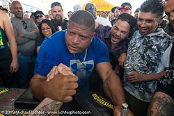 Arm wrestling competition on Main Street during Daytona Beach Bike Week, FL. USA. Saturday, March 16, 2019. Photography ©2019 Michael Lichter.