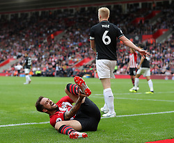 Southampton's Danny Ings (left) goes to ground after a challenge from Burnley's Ben Mee during the Premier League match at St Mary's, Southampton.