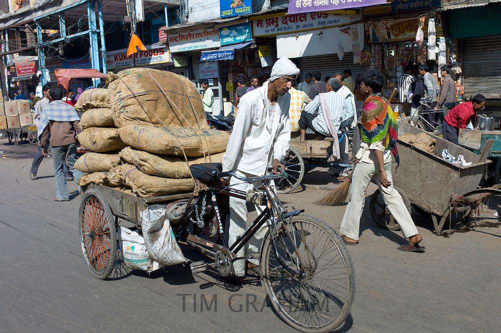 Porters at Khari Baoli spice and dried foods market, Old Delhi, India