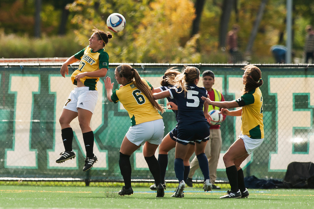 Vermont's Nikki McFarland (17) heads the ball during the women's soccer game between the New Hampshire Wildcats and the Vermont Catamounts at Virtue Field on Thursday afternoon October 1, 2015 in Burlington. (BRIAN JENKINS/ for the FREE PRESS)