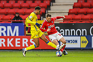Charlton Athletic forward Conor Washington (14) and AFC Wimbledon defender Terell Thomas (6) during the EFL Sky Bet League 1 match between Charlton Athletic and AFC Wimbledon at The Valley, London, England on 12 December 2020.