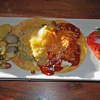 Huevos rancheros with red and green salsas make a delicious breakfast for guests at the Inn of the Five Graces in Santa Fe, New Mexico.