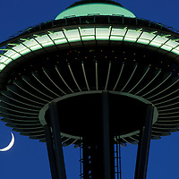 USA, Washington, Seattle, Setting crescent moon sets behind Space Needle in evening twilight sky