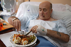 Hospital patient eating dinner,