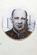 vintage deteriorating round identity photo of adult man