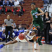Ariel Hearn, Memphis, is tripped by Kolby Morgan, Tulane, during the Tulane Green Wave Vs Memphis Tigers Quarter Final match at the  2016 American Athletic Conference Championships. Mohegan Sun Arena, Uncasville, Connecticut, USA. 5th March 2016. Photo Tim Clayton