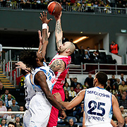 Olympiacos's Pero Antic (C) during their Euroleague Basketball Game 7 match Fenerbahce Ulker between Olympiacos at Sinan Erdem Arena in Istanbul, Turkey, Thursday, December 01, 2011. Photo by TURKPIX