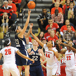 Notre Dame Fighting Irish guard Kayla McBride (23) launches a shot over Rutgers Scarlet Knights guard/forward Betnijah Laney (44) and guard Shakena Richardson (22) during second half NCAA Big East women's basketball action between Notre Dame and Rutgers at the Louis Brown Athletic Center. Notre Dame defeated Rutgers 71-41.