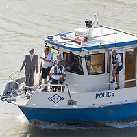 Sandor Pinter (L) Hungary's Minister of Interior observes rescue operations from a police boat as rescue personnel recovers bodies from the passenger boat Hableany (means Mermaid in Hungarian) lifted up from the river after it's capsize in an accident on river Danube in downtown Budapest, Hungary on June 11, 2019. ATTILA VOLGYI