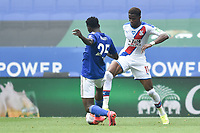 LEICESTER, ENGLAND - JULY 04: Wilfred Ndidi of Leicester City tackles Wilfried Zaha of Crystal Palace during the Premier League match between Leicester City and Crystal Palace at The King Power Stadium on July 4, 2020 in Leicester, United Kingdom. Football Stadiums around Europe remain empty due to the Coronavirus Pandemic as Government social distancing laws prohibit fans inside venues resulting in all fixtures being played behind closed doors. (Photo by MB Media)