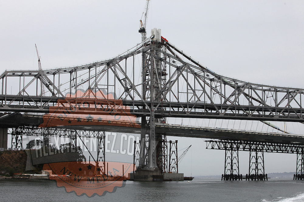 The San Francisco-Oakland Bay Bridge is under construction, and scheduled to open Labor Day 2013. The Self-Anchored Suspension Span (SAS) is the largest bridge of its kind in the world measuring 2,047 feet. This engineering and construction marvel raises the bridge building bar to new heights, as seen in these behind the scenes photos taken on Monday, March 18, 2013. This image shows the support structure under the new spans. (AP Photo/Alex Menendez)