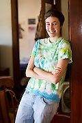 Zoe Schein '12 poses for a portrait in her Main St. apartment in Grinnell, Iowa. BEN BREWER/Grinnell College