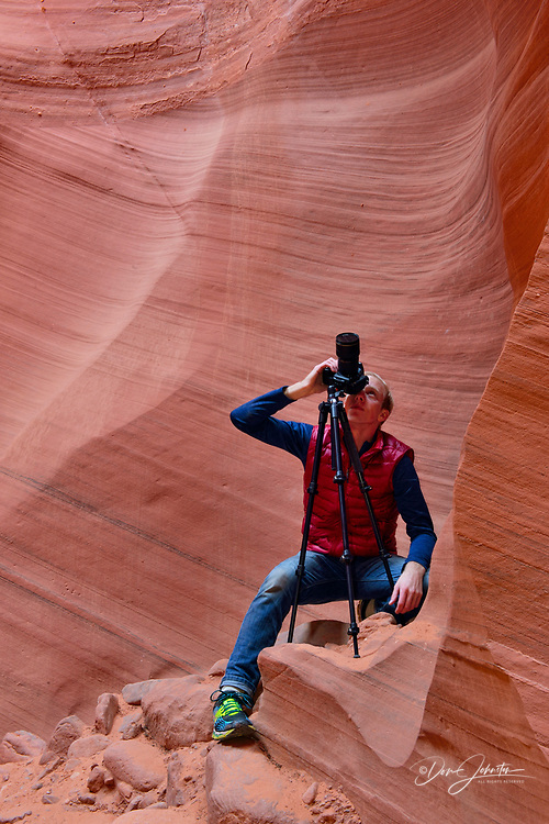 Photographing th eroded Navajo Sandstone in the Lower Antelope Canyon, Page, Arizona, USA