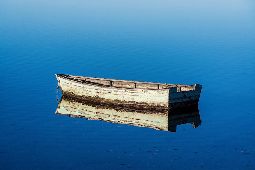 Rowboat on still salt pond, Sengekontacket Pond, Martha's Vineyard, Massachusetts, USA.