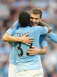 01.09.2012, Etihad Stadion, Manchester, ENG, Premier League, Manchester City vs Queens Park Rangers, 2. Runde, im Bild Manchester City's Carlos Tevez celebrates scoring the third goal against Queens Park Rangers with Edin Dzeko during the English Premier League 2nd round match between Manchester City and Queens Park Rangers at the Etihad Stadium, Manchester, Great Britain on 2012/09/01. EXPA Pictures © 2012, PhotoCredit: EXPA/ Propagandaphoto/ David Rawcliff..***** ATTENTION - OUT OF ENG, GBR, UK *****