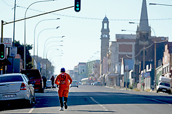 JOHANNESBURG, SOUTH AFRICA - MAY 10: A general view of people exercising in Jeppestown during lockdown level 4 on May 10, 2020 in Johannesburg, South Africa. According to media reports, during lockdown level 4 people are allowed to exercise. Guidelines allow for cycling, running and walking as examples and must be within a 5km radius of their residences between 6:00 am – 9:00 am. (Photo by Dino Lloyd)