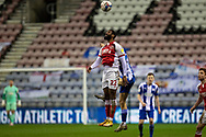 Fleetwood Town defender Janoi Donacien (22)jumps for the ball during the EFL Sky Bet League 1 match between Wigan Athletic and Fleetwood Town at the DW Stadium, Wigan, England on 23 January 2021.