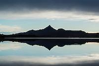 Reflection of Skottinden mountain peak in Lake, Vestvågøya, Lofoten Islands, Norway