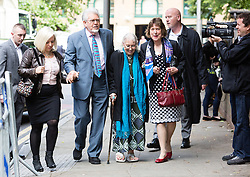 © Licensed to London News Pictures. 02/06/2014. London, UK. Artist and television personality, Rolf Harris arrives at Southwark Crown Court in London on 2nd June 2014 with his daughter Bindi Harris and wife Alwen Hughes. Rolf Harris denies 12 counts of indecent assault against four girls and women between 1968 and 1986. Photo credit : Vickie Flores/LNP