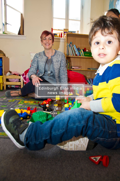 Pictured: Ilyes Hamza was more interested in the fuss that meeting Angela Constance, Communities Secretary<br /> Today Communities Secretary  Angela Constance visited Dr Bells family centre, where she met staff and volunteers ahead of the first Tackling Child Poverty Delivery Plan being published.<br /> <br /> <br /> Ger Harley   EEm 29 March 2018
