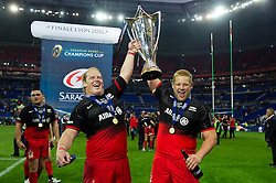 Petrus Du Plessis and Richard Barrington of Saracens lift the European Rugby Champions Cup after the match - Mandatory byline: Patrick Khachfe/JMP - 07966 386802 - 14/05/2016 - RUGBY UNION - Grand Stade de Lyon - Lyon, France - Saracens v Racing 92 - European Rugby Champions Cup Final.