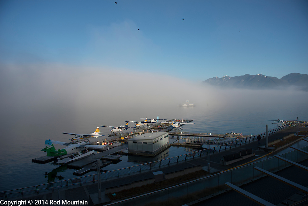 Float Planes await the day as the fog drifts across Coal Harbour
