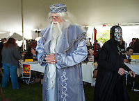 Professor Albus Dumbledore - Jeff Peterson of Oxford, Michigan and Death Eater - Mark Sawyer meander the front lawn at the Margate Resort on Saturday for wizardry and Harry Potter fans during Misti-Con 2015.  (Karen Bobotas/for the Laconia Daily Sun)
