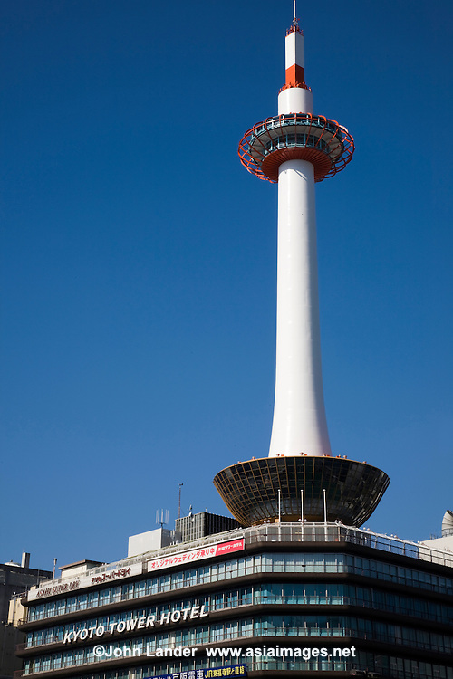Kyoto Tower is an observation tower is the tallest structure in Kyoto with its observation deck at 100 meters. The 800-ton tower stands atop a 9-story building which houses a 3-star hotel and several stores. The entire complex stands opposite Kyoto Station and though once considered the height of modern Japan is now considered a kitsch land