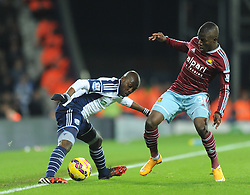 West Bromwich Albion's Youssuf Mulumbu is closed down by West Ham's Enner Valencia - Photo mandatory by-line: Dougie Allward/JMP - Mobile: 07966 386802 - 02/12/2014 - SPORT - Football - West Bromwich - The Hawthorns - West Bromwich Albion v West Ham United - Barclays Premier League