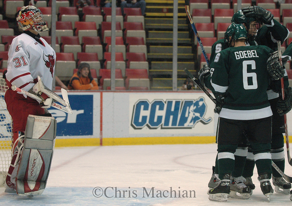 03/17/05 Detroit Michigan. Univ of Neb Omaha goalie Chris Holt watches as Michigan State's third goal scored by Tommy Goebel   in the second period Thursday night during the first game of the CCHA Super Six at Joe Louis Arena.