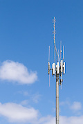 3 sector cellular telecom communications panel antenna array for the mobile telephone system on a cellsite pole tower with two-way radio antennas. <br /> <br /> Editions:- Open Edition Print / Stock Image