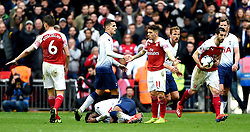 Tottenham Hotspur's Danny Rose goes to ground after a red card challenge from Arsenal's Lucas Torreira (11)