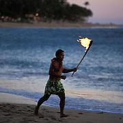 A Hawaiian man runs along the beach in a torch lighting ceremony in Ka'anapali on the island of Maui.